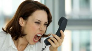 Woman with telephone rage